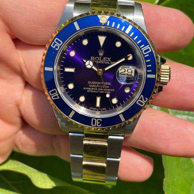 FS - Rolex Submariner ref.16613. Purple dial. Box and Papers. Unpolished. Mint conditions.