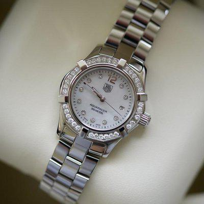 FS: NIB unworn Ladies Tag Heuer Aqua Racer with factory diamond dial and bezel.